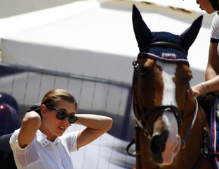 Charlotte Casiraghi prepares to compete in the 1.25 meters special jumping competition at the Global Champions Tour of Monaco