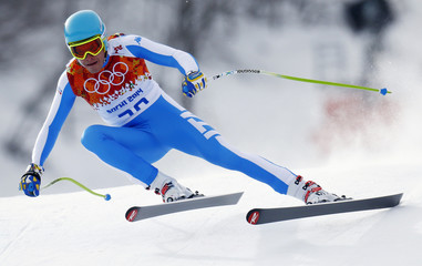 Italy's Christof Innerhofer speeds down the slope during the men's alpine skiing downhill race at the 2014 Sochi Winter Olympics