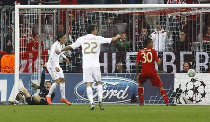 Real Madrid's Oezil scores against Bayern Munich during their Champions League semi-final first leg soccer match in Munich
