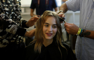 A model has her hair done backstage before the Bill Gaytten Spring/Summer 2017 women's ready-to-wear collection for fashion house John Galliano during Fashion Week in Paris