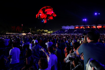 An inflatable pig floats over the crowd during a performance by Roger Waters at Desert Trip music festival at Empire Polo Club in Indio