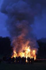 Spectators watch a traditional easter fire in Oberhaeuslingen