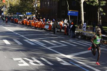 Geoffrey Mutai of Kenya breaks away from the pack during the 2011 New York City Marathon