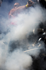 Adam Schroeder, of Milwaukee, Wisconsin, revs his bike during the Sundance Burnouts