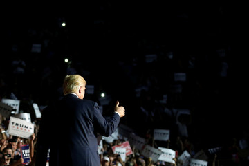 Trump arrives onstage for a rally with supporters in Roanoke, Virginia, U.S.
