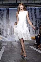 A model presents a creation from the DKNY Spring/Summer 2013 collection during New York Fashion Week