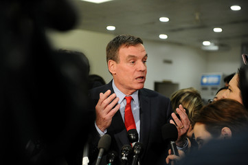 Sen. Mark Warner  speaks to the media after Deputy U.S. Attorney General Rod Rosenstein's classified briefing for the full U.S. Senate on President Donald Trump's firing of FBI Director James Comey in Washington