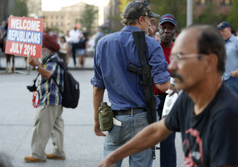 A man openly carries a rifle at Public Square near the Republican National Convention in Cleveland