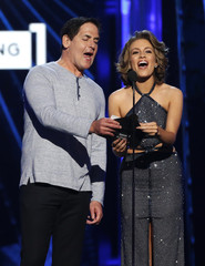 Entrepenour Mark Cuban and Betty Cantrell announce the winner for Top Country Song at the 2016 Billboard Awards in Las Vegas