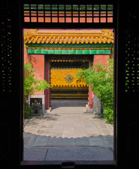 Colorful traditional Chinese gateway with ceramic tiles