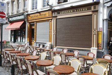 Empty cafe tables following bomb attacks in Brussels, Belgium