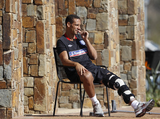 England's Ferdinand watches during a World Cup soccer training session near Rustenburg