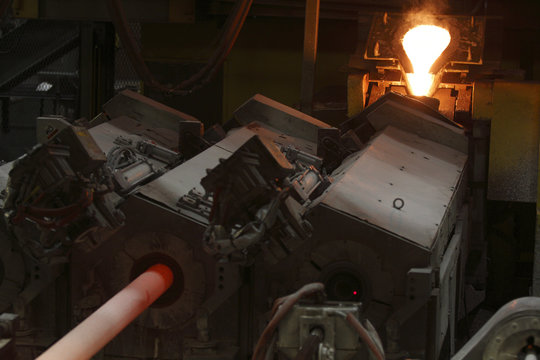 Molten steel is seen being poured into a spin casting machine as a finished rod comes out during a tour of the Honda automotive engine plant in Anna