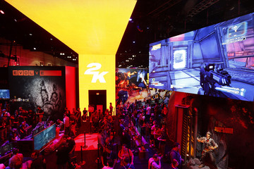 People gather at the Take Two booth during the 2014 Electronic Entertainment Expo, known as E3, in Los Angeles