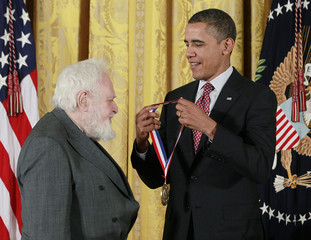 U.S. President Obama presents the National Medal of Science to Dr. Solomon Golomb from the University of Southern California during a ceremony in the East Room of the White House in Washington