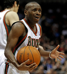 Milwaukee Bucks' Boykins reacts after being called with traveling against the Miami Heat in the first overtime during their NBA basketball game in Milwaukee