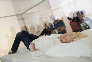 "Actress Tilda Swinton sleeps in a box for her performance piece called ""The Maybe."", at the Museum of Modern Art in New York"