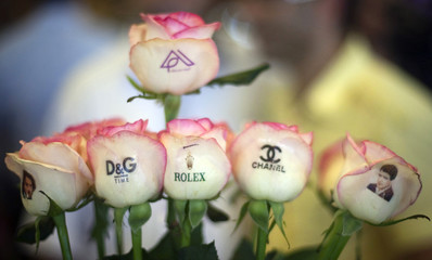 Logos are printed on Roses displayed at Tehran's International flower and plant fair