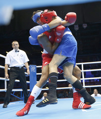 Larduet Gomez of Cuba (red) and Iran's Ali Mazaheri fight during their Men's Heavy (91kg) Round of 16 boxing match at the London 2012 Olympic Games