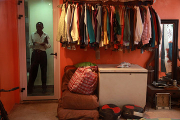 Clothes worn by Nigeria's music legend Fela Kuti are seen on hangers in a room during the opening ceremony of a museum in his honour in Lagos