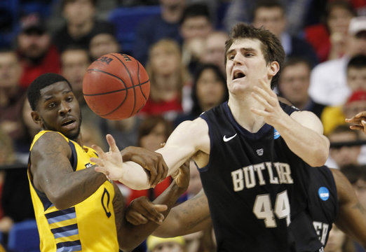 Marquette University's Wilson fights for loose ball with Butler University's Smith during their third round NCAA basketball game in Lexington