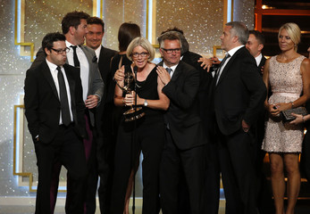 """The crew of """"The Ellen DeGeneres Show"""" accept the award for outstanding talk show/entertainment during the 41st Annual Daytime Emmy Awards in Beverly Hills"""