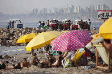 Beachgoers enjoy a day at Agua Dulce beach in Lima's district of Chorrillos