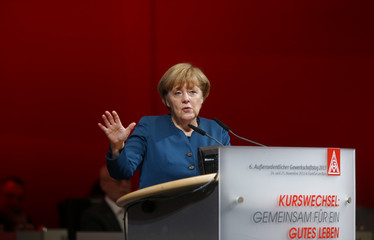 German Chancellor Merkel gestures as she makes a speech during the Germany's metal worker union IG Metall meeting in Frankfurt