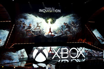 """Electronic Arts chief operating officer Peter Moore introduces the """"Dragon Age: Inquisition"""" video game during game publisher Microsoft's Xbox media briefing before the opening day of the Electronic Entertainment Expo, or E3, in Los Angeles"""