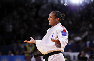 Lucie Decosse of France celebrates winning her under 70kg women's semi - final bout against Anett Meszaros of Hungary at the World Judo Championships in Paris