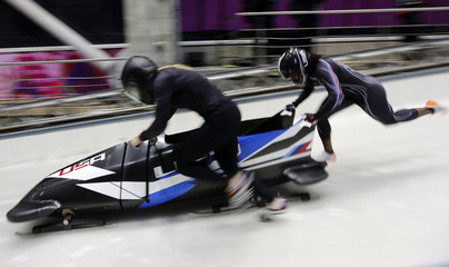 Two-women bobsleigh pilot Jamie Greubel of the U.S. starts an unofficial women bobsleigh progressive training at the Sanki Sliding Center in Rosa Khutor