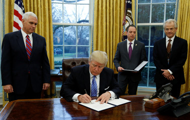 President Trump signs executive orders at the White House in Washington