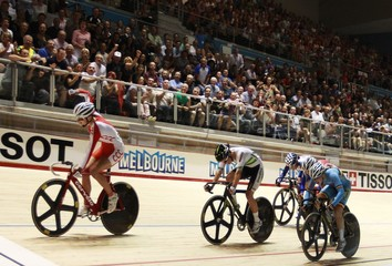 Poland's Pawlowska crosses finish line to win ahead of Australia's Hoskins and Belgium's Druyts at 2012 UCI Track Cycling World Championships in Melbourne