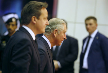 Britain's Prince Charles and PM Cameron arrive to offer condolences following the death of Saudi King Abdullah in Riyadh