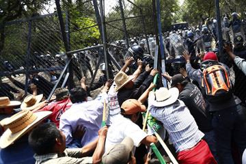Farmers remove a fence during a protest at Los Pinos presidential house in Mexico City