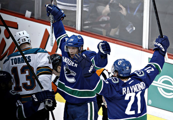 Vancouver Canucks Hansen celebrates his goal against the San Jose Sharks with teammate Raymond during their NHL Western Conference quarter final hockey playoff in Vancouver