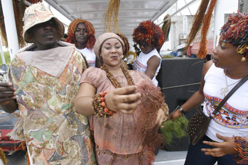 Models display creations made with raffia, a natural fibre drawn from a palm tree, during a fashion show organized by Ivorian designer Genevieve Koukougnon, in Abidjan