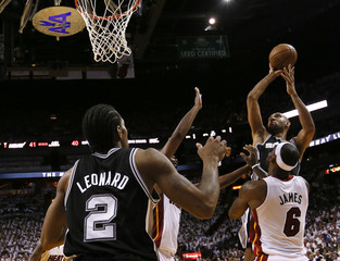 Spurs' Duncan shoots over Heat's James during Game 2 of  the NBA Finals in Miami