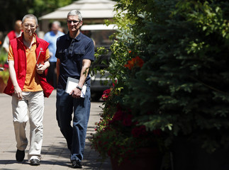 Chinese internet entrepreneur Victor Koo and Apple CEO Tim Cook attend the Allen & Co Media Conference in Sun Valley