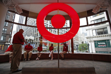 Employees at a new CityTarget store receive instructions as they prepare for its opening in downtown Chicago