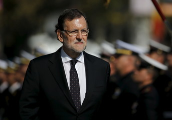 Spain's PM Mariano Rajoy reviews troops during a military ceremony in Madrid, Spain