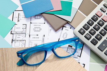 Home Design - Interior Decorating with house drawings, samples, calculator and eyeglasses