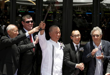 Chef Nobu Matsuhisa (3rd L) holds up a Japanese ceremonial knife during the opening of Nobu Hotel in Pasay city, Metro Manila in the Philippines