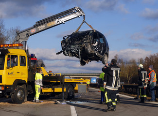 The wreckage of a wrong-way driver's car is lifted on a towtruck on the highway A92 near Moosburg