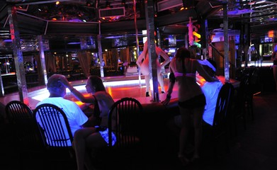 Strip dancers perform for customers at the Mons Venus strip club in Tampa