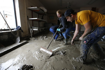 Residents clear mud from a launderette damaged by floods in the Bavarian village of Simbach am Inn east of Munich