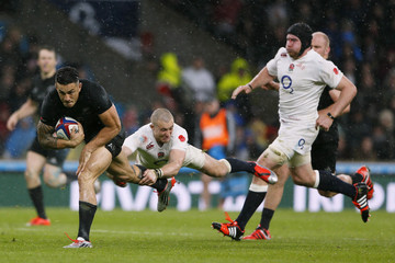 New Zealand's Williams is tackled by England's Mike Brown during their international rugby union match at Twickenham in London