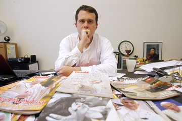 """Leo Fischer, editor-in-chief of the German magazine """"Titanic"""", poses for a picture in his office in Frankfurt"""