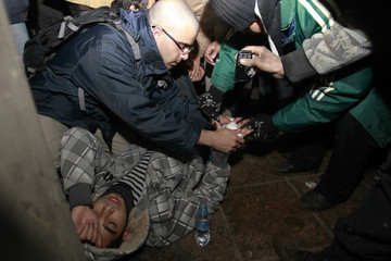 Medics treat an injured anti-government protester in Amman