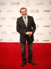 Syrian director Hatem Ali arrives on red carpet during Abu Dhabi Film Festival